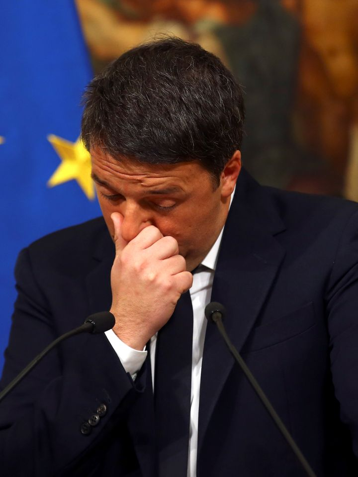 Italian Prime Minister Matteo Renzi gestures during a media conference after a referendum on constitutional reform at Chigi p