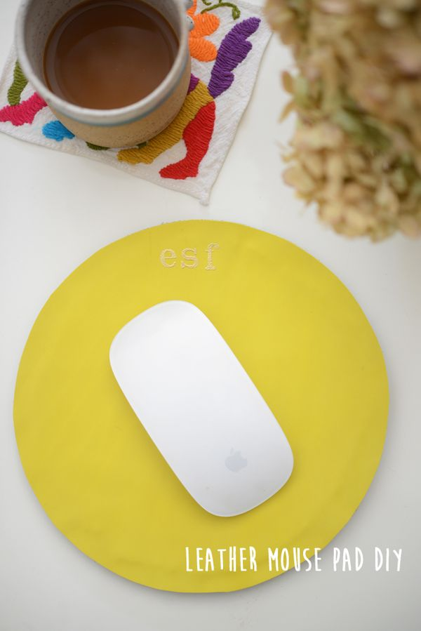 "<strong>Get the directions for the <a href=""http://cupcakesandcashmere.com/diy/monogrammed-leather-mouse-pad-diy"" target=""_bl"