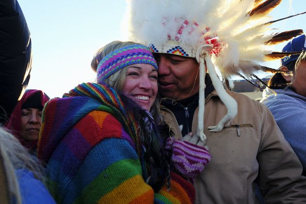 Lance King, 33, an Oglala Lakota from Lyle, South Dakota, celebrates with Kayti Bunny after the announcement...