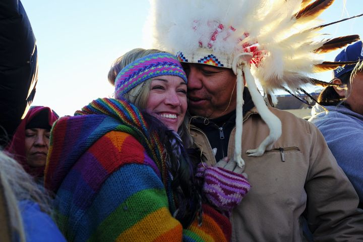 Lance King, 33, an Oglala Lakota from Lyle, South Dakota, celebrates with Kayti Bunny after the announcement that the Army Corps of Engineers denied the easement to drill under Lake Oahe for the Dakota Access Pipeline.