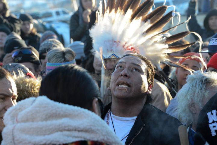 People celebrate in Oceti Sakowin camp.