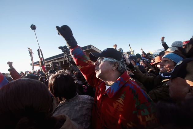 Native American and other activists celebrate after learning an easement had been