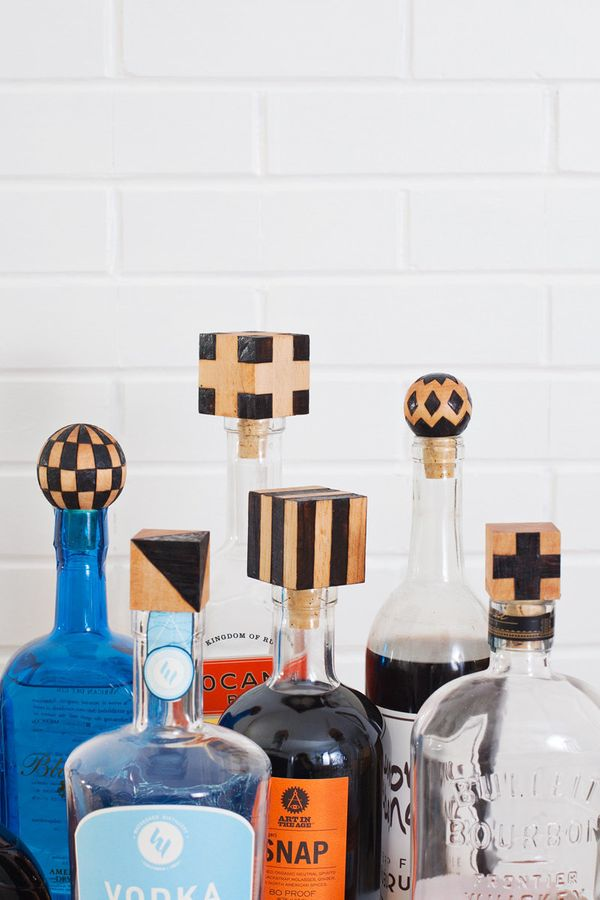 "<strong>Get the directions for <a href=""http://www.abeautifulmess.com/2016/02/diy-wood-burned-bottle-stoppers.html"" target=""_"