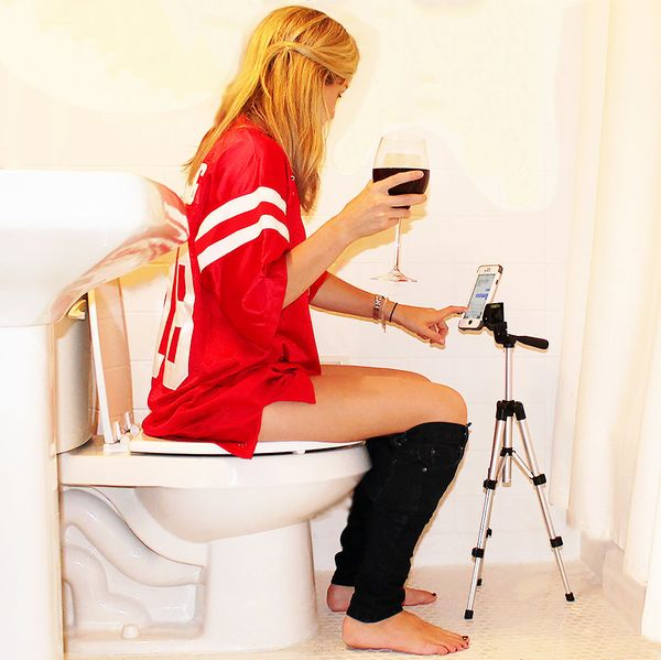 Texting in a bathroom isn't easy. You have to hold the phone with both hands, leaving nothing to hold a glass of wine (or any