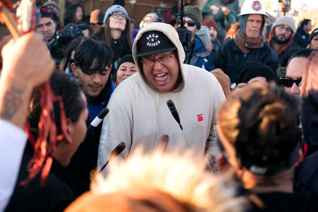 Drummers at the Oceti Sakowin campground perform a victory