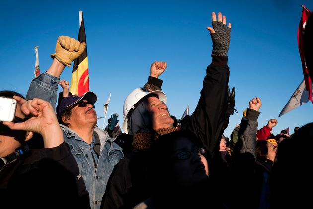 Dakota Access Pipeline protesters celebrate after learning that the Army Corps of Engineers denied the...