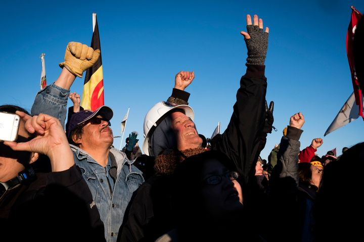 Dakota Access Pipeline protesters celebrate after learning that the Army Corps of Engineers denied the drilling permit to drill under Lake Oahe near Cannon Ball, North Dakota.