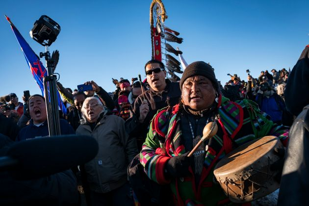 Dakota Access Pipeline protesters participate in a victory march to the Oceti Sakowin