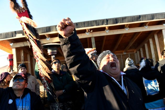 Troy Fairbanks, right, of the Standing Rock Sioux tribe cheers after hearing Chief Arvol Looking Horse...