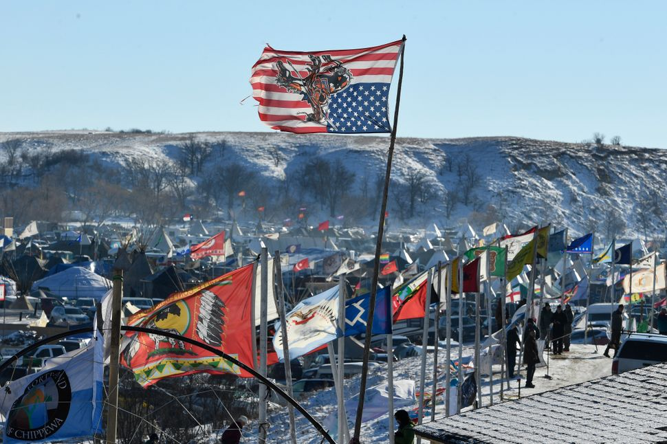 A Sioux American flag hangs upside down at the encampment at Oceti Sakowin camp on the Standing Rock Sioux Reservation.