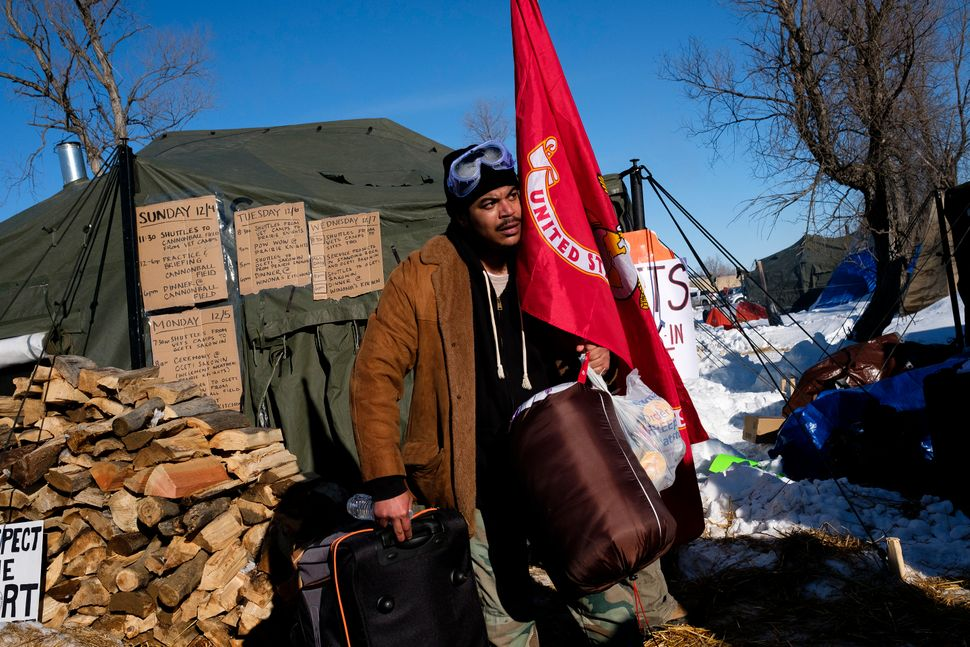Evan Porter, a veteran of the U.S. Marine Corps, checks into the Oceti Sakowin campground.