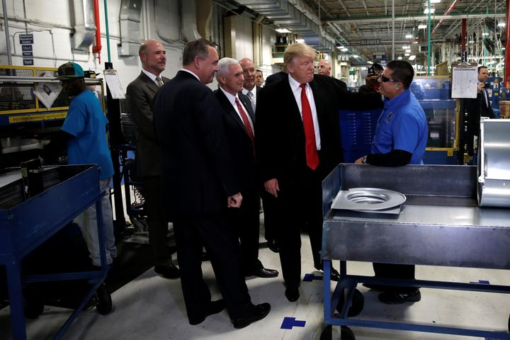 U.S. President-elect Donald Trump tours a Carrier factory with Greg Hayes, CEO of United Technologies (L) in Indianapolis, In