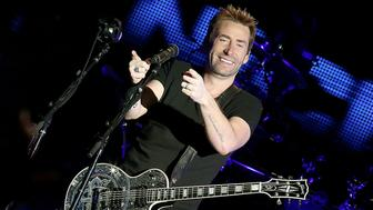 AUSTIN, TX - APRIL 04:  Chad Kroeger of Nickelback performs in concert at the Austin360 Amphitheater on April 4, 2015 in Austin, Texas.  (Photo by Gary Miller/Getty Images)