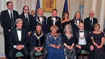WASHINGTON, DC - DECEMBER 03: The five recipients of the 39th Annual Kennedy Center Honors pose for a group photo following a dinner hosted by United States Secretary of State John F. Kerry in their honor at the U.S. Department of State in Washington, D.C. on Saturday, December 3, 2016.  The 2016 honorees are: Argentine pianist Martha Argerich; rock band the Eagles; screen and stage actor Al Pacino; gospel and blues singer Mavis Staples; and musician James Taylor. From left to right back row: Ricky Kirshner, Glenn Weiss, Joe Walsh, Don Henley, Cindy Frey, wife of Glenn Frey, who passed away earlier this year, and Timothy B. Schmidt of the rock band 'The Eagles'  and David M. Rubenstein, Chairman, John F. Kennedy Center for the Performing Arts.  Front row, left to right: United States Secretary of State John Kerry, Al Pacino, Mavis Staples, Martha Argerich, James Taylor and Deborah F. Rutter, President of the John F. Kennedy Center for the Performing Arts.  (Photo by Ron Sachs - Pool via Getty Images)