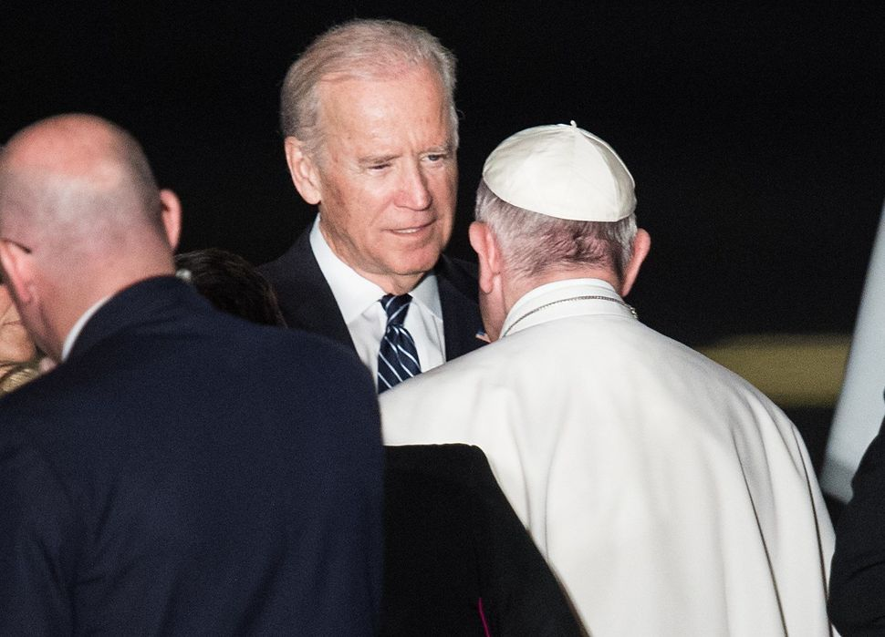 US Vice President Joe Biden bids farewell to Pope Francis before he boards his plane in Philadelphia on September 27, 2015 at