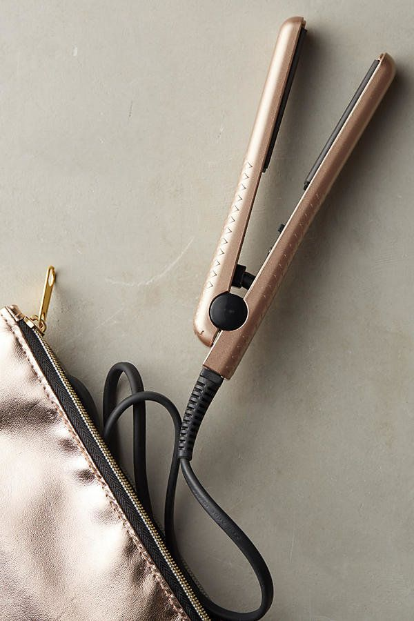 "Eva NYC Mini Healthy Heat ceramic styling iron, $30, <a href=""https://www.anthropologie.com/shop/eva-nyc-mini-healthy-heat-ceramic-styling-iron3?category=beauty-travel&color=025"" target=""_blank"">Anthropologie</a>"