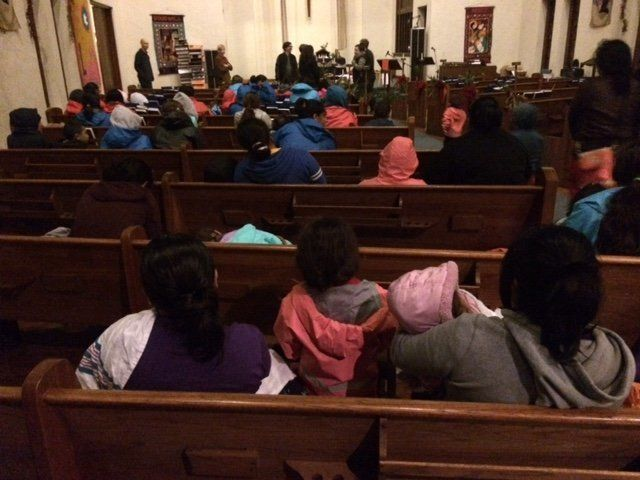 Women and children gather in a church after being released from family immigrant detention centers in Texas this past weekend