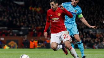 Britain Football Soccer - Manchester United v Feyenoord - UEFA Europa League Group Stage - Group A - Old Trafford, Manchester, England - 24/11/16 Manchester United's Henrikh Mkhitaryan in action with Feyenoord's Dirk Kuyt Action Images via Reuters / Carl Recine Livepic EDITORIAL USE ONLY.