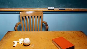 Teacher's desk with peeled orange on top