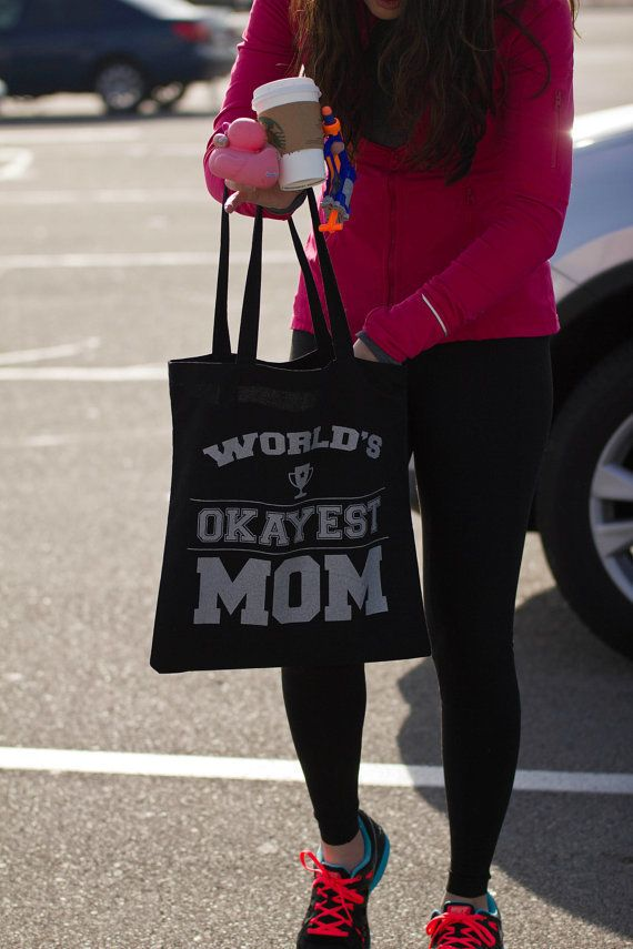 """$12, Seeker of Happiness.<a href=""""https://www.etsy.com/listing/220160056/worlds-okayest-mom-tote-bag"""" target=""""_blank"""">B"""