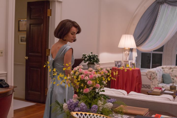 Natalie Portman as Jackie Kennedy, trying on gowns.