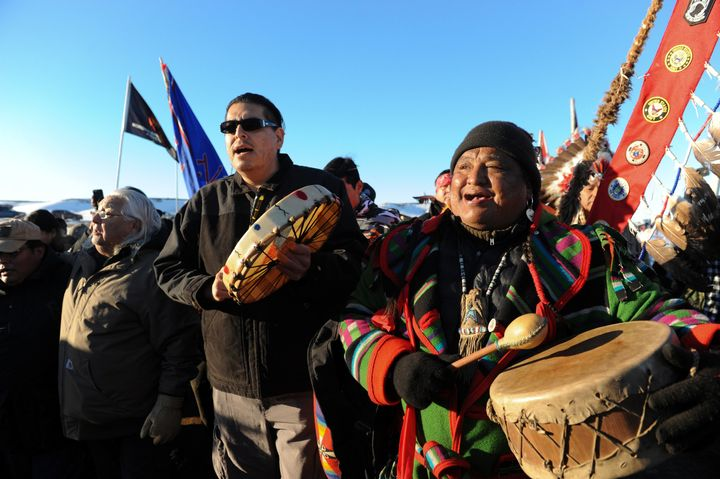 """People celebrate in Oceti Sakowin camp as """"water protectors"""" continue to demonstrate against plans to pass the Dakota Access"""