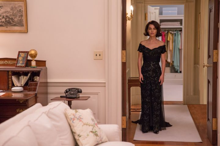 Natalie Portman as Jackie Kennedy, trying on more gowns.