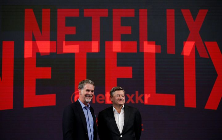 Reed Hastings, co-founder and CEO of Netflix, and Ted Sarandos, Netflix chief content officer, pose for photographs in Seoul,
