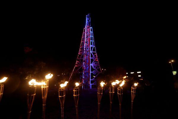 People gather near a kinetic Christmas tree in Rakvere, Estonia, November 27, 2016.