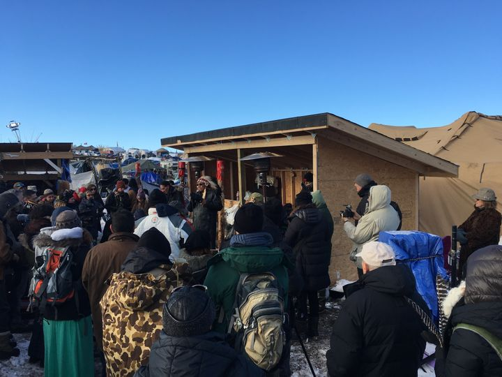 An interfaith prayer event takes place at the Oceti Sakowin camp.