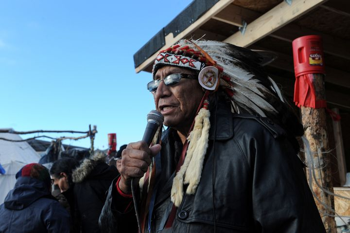 Chief Arvol Looking Horse, a Native American spiritual leader of the Sioux nation, speaks to participants during a cerem