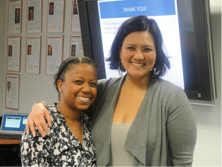 "<i>Maung-Gaona congratulates Ph.D. student Felicia Jackson after she gives a ""Research Café"" presentation<"