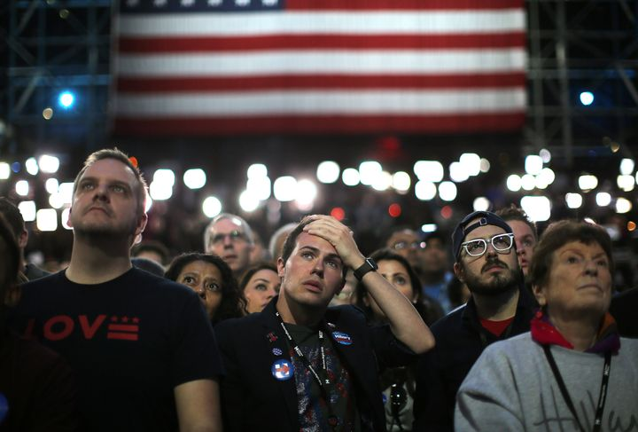 Supporters of Democratic presidential nominee Hillary Clinton watch and wait at her election night rally in New York, U.S., N