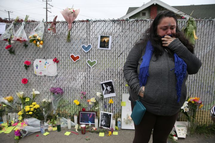 """Danielle Boudreaux, 40, who went to the """"Ghost Ship"""" warehouse many times, cries Monday at a sidewalk memorial near the burne"""