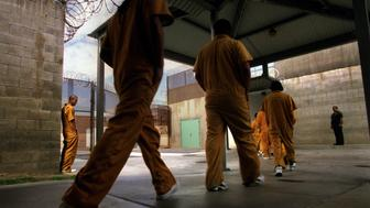 039778.AA.0411.JesseLine.GF. Walking single file, inmates at Theo Lacy Men's Jail enter the mess hall to eat lunch. 'I'm lost and lonely in here man. This is hell,' Jesse says, on the verge of tears.  (Photo by Gail Fisher/Los Angeles Times via Getty Images)
