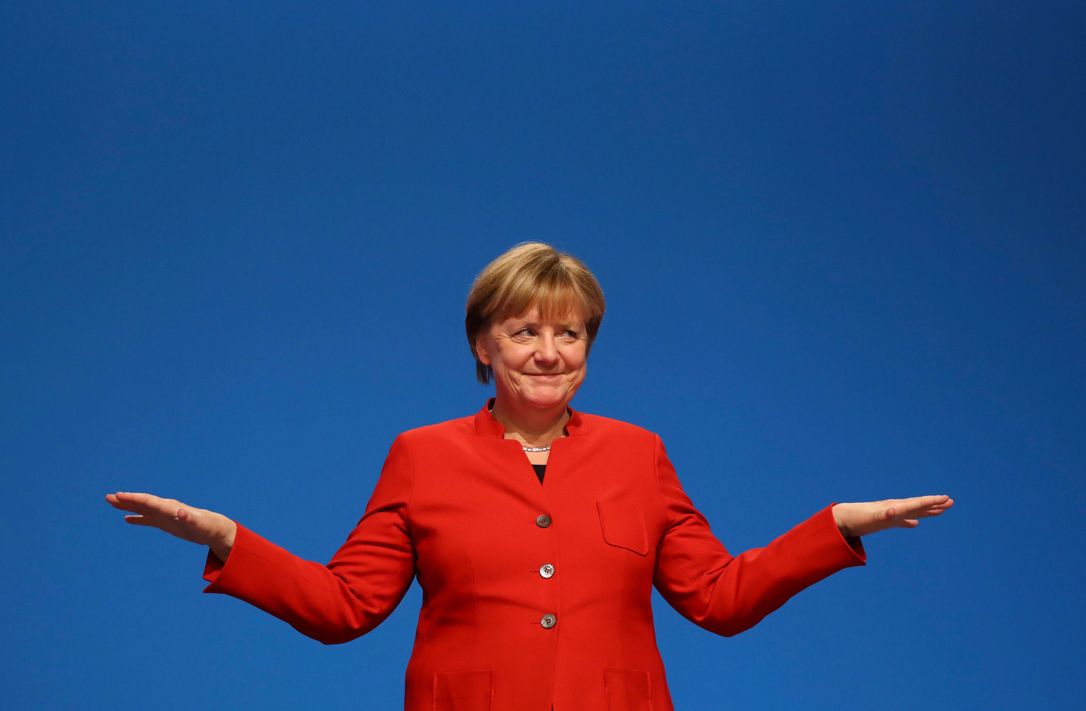 German Chancellor and leader of the conservative Christian Democratic Union party CDU Angela Merkel reacts after her speech a