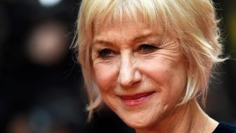 Helen Mirren poses for photos at the UK premiere of Eye in the Sky, at a cinema in central London, Britain April 11, 2016.   REUTERS/Dylan Martinez