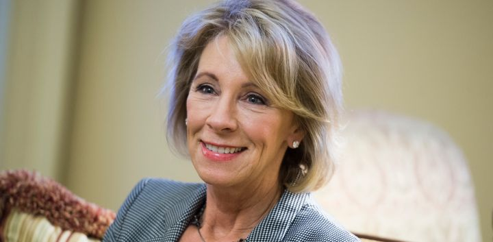 <p>Betsy DeVos, nominee for education secretary, poses for a photo before a meeting with Senate Majority Leader Mitch McConnell, R-Ky., in the Capitol, December 1, 2016.</p>