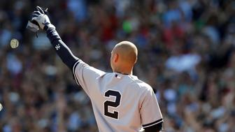 Sep 28, 2014; Boston, MA, USA; New York Yankees shortstop Derek Jeter (2) waves to the crowd after being replaced by a pinch runner during the third inning against the Boston Red Sox at Fenway Park. Mandatory Credit: Greg M. Cooper-USA TODAY Sports