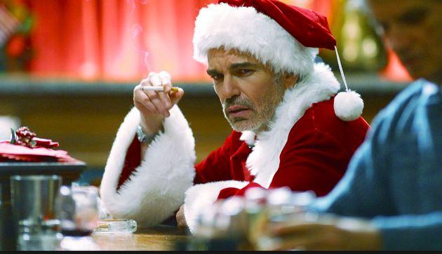 Billy Bob Thornton smokes while sitting at a bar in the movie Bad Santa; a Santa at a winter wonderland...