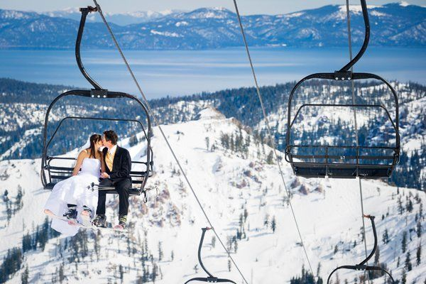 A ski lift offers a bird's eye view of a stunning scenery, complete with mountain and lake.