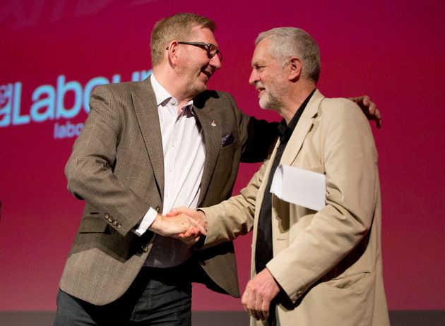 Labour leader Jeremy Corbyn shakes hands with General Secretary of Unite, Len