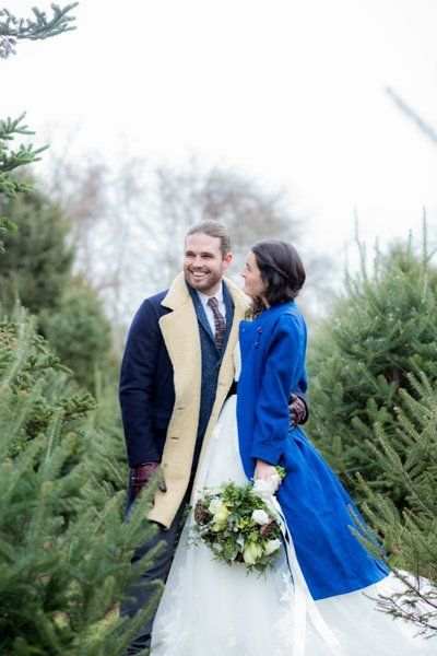 "Surrounded by fresh evergreens and wrapped in peacoats, this couple is full of <a href=""http://bridalguide.com/planning/the-d"