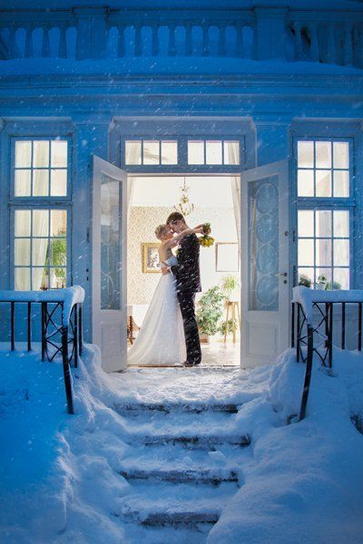 This couple looks cozy in love as the snow rages outside in a shot that captures both the warmth and the cold.