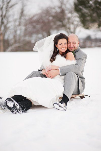 "A sled acts as a fun prop with playtime vibes, bringing out this couple's <a href=""http://www.bridalguide.com/planning/the-de"