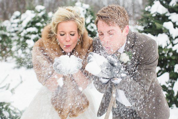 "Snowball fight, anyone? These two know how to have fun, creating winter's version of <a href=""http://www.bridalguide.com/blog"
