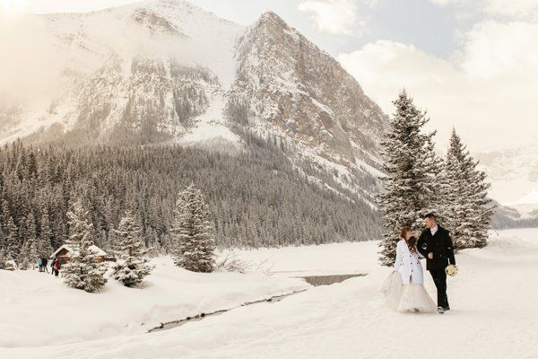 A cozy lodge in the background adds an element of warmth to this magical and chilly scene. This couple really is walking in a
