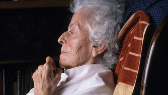 Portrait of a seated elderly woman.