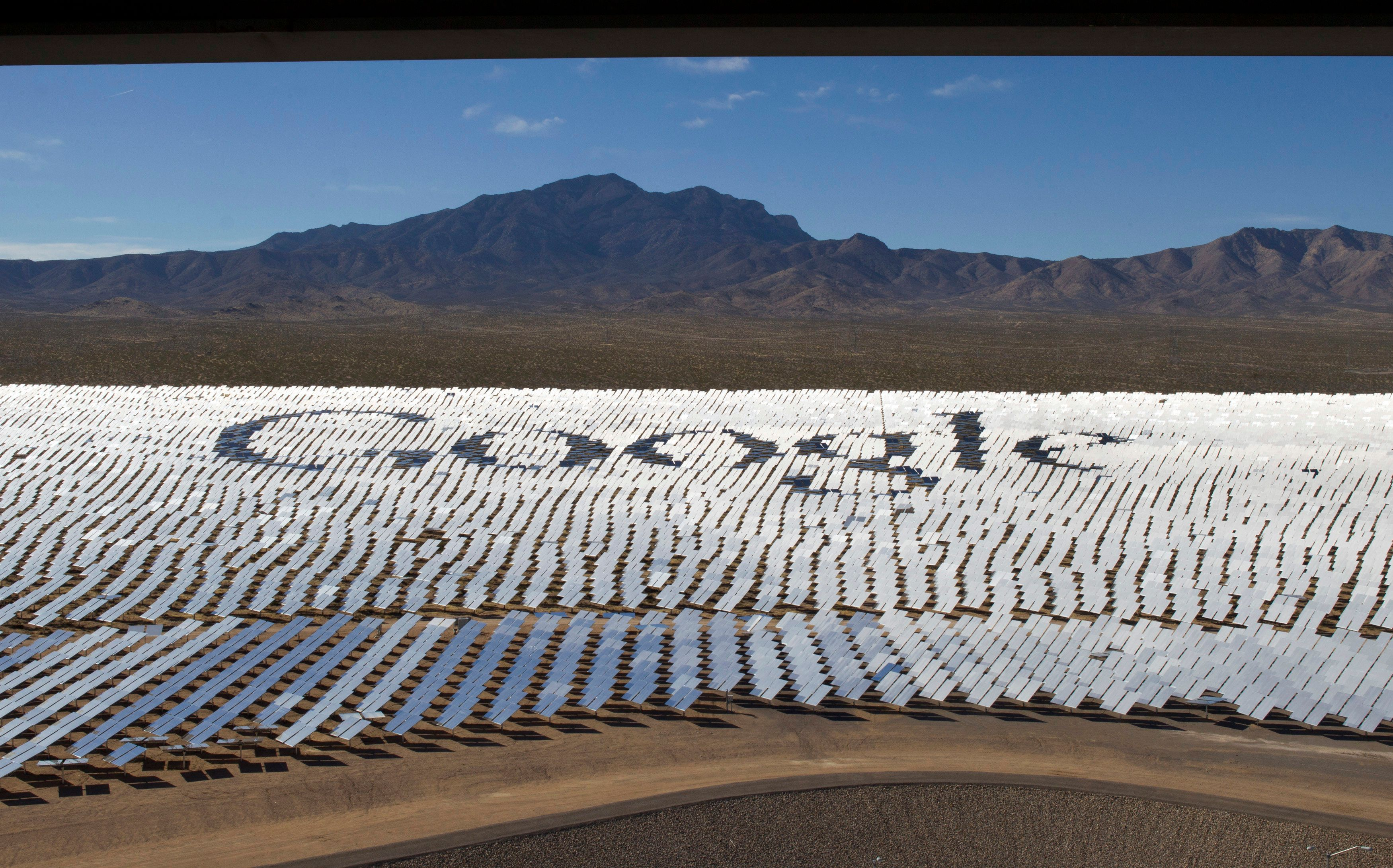 The Google logo is spelled out in heliostats (mirrors that track the sun and reflect the sunlight onto a central receiving point) during a tour of the Ivanpah Solar Electric Generating System in the Mojave Desert near the California-Nevada border February 13, 2014. The project, a partnership of NRG, BrightSource, Google and Bechtel, is the world's largest solar thermal facility and uses 347,000 sun-facing mirrors to produce 392 Megawatts of electricity, enough energy to power more than 140,000 homes. REUTERS/Steve Marcus (UNITED STATES - Tags: ENERGY SCIENCE TECHNOLOGY BUSINESS TPX IMAGES OF THE DAY LOGO)