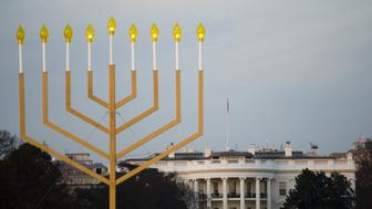 The National Menorah, part of the Jewish holiday of Hanukkah, is seen near the White House in Washington, DC on December 10, 2015.   The holiday commemorates the re-dedication of the holy temple in Jerusalem after the Jews' 165 B.C. victory over the Hellenist Syrians when Antiochus, the Greek King of Syria, outlawed Jewish rituals and ordered the Jews to worship Greek gods.  / AFP / Andrew Caballero-Reynolds        (Photo credit should read ANDREW CABALLERO-REYNOLDS/AFP/Getty Images)